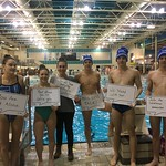 Swim teams with signs (Jan 31, 2018  McChesney photo)
