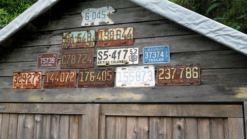 Old BC license plates nailed onto a garage in Tofino, Vancouver Island, Canada