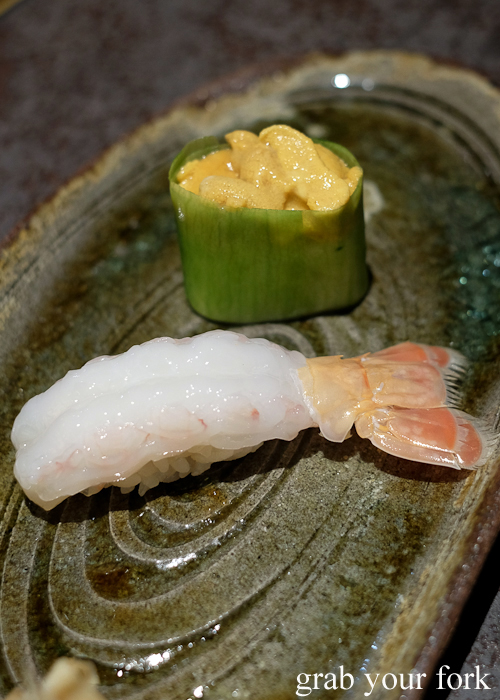 Sashimi scampi nigiri sushi and sea urchin roe in cucumber wrapped gunkan maki, part of our omakase by Chef Ryuichi Yoshii at Fujisaki by Lotus at Barangaroo in Sydney