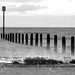 Distant beach posts.