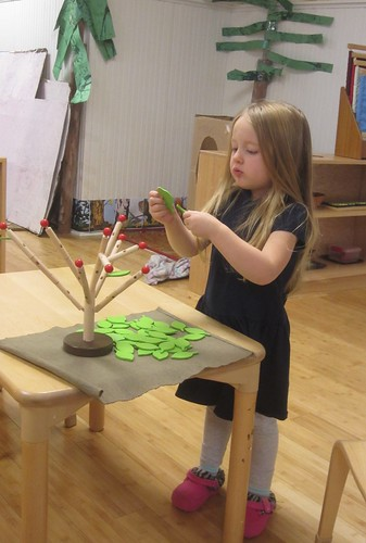 putting leaves and berries on a tree
