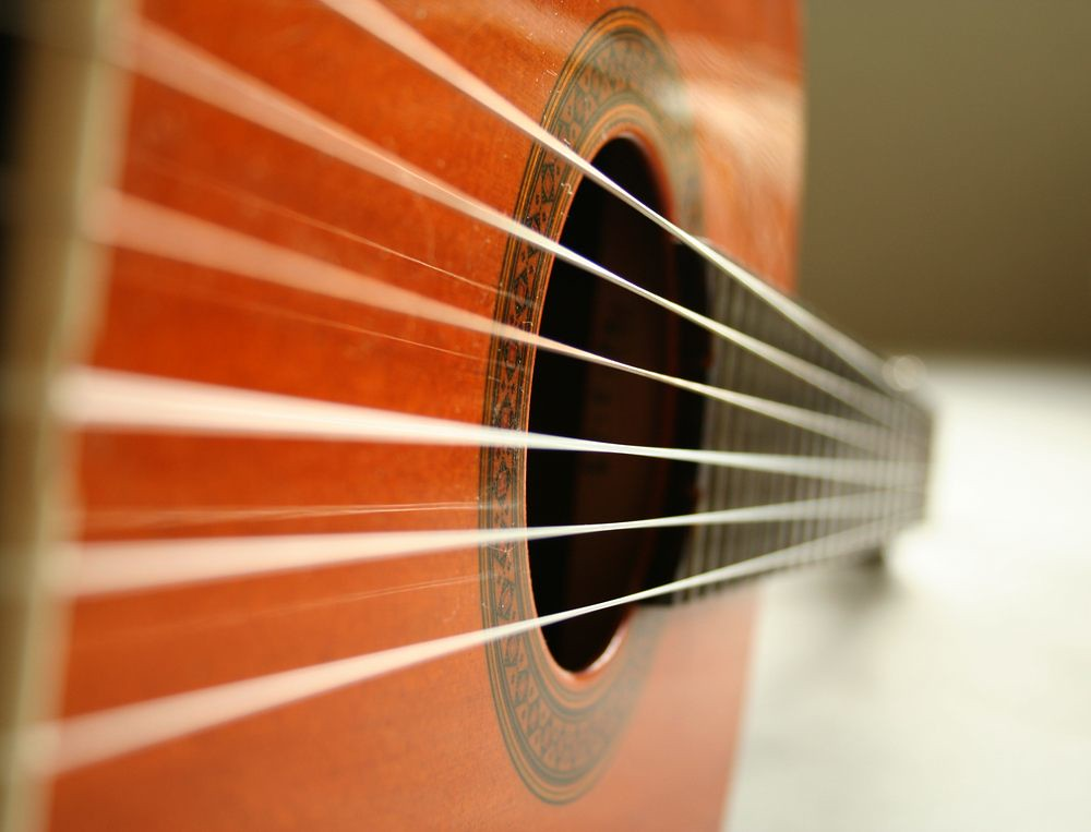 close-up photo of classical guitar and strings
