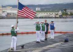 PEARL HARBOR, Hawaii (Feb. 14, 2018) Sailors aboard USS Texas (SSN 775) render honors to the national ensign as the Virginia-class fast-attack ties up to the pier at Joint Base Pearl Harbor-Hickam after completing a Western Pacific deployment. (U.S. Navy photo by Mass Communication Specialist 2nd Class Michael H. Lee/ Released)