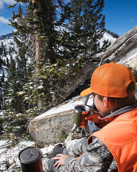 Eli Beyer sips his hot cocoa while searching for a buck.