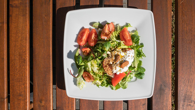 Summer salad with mangel, tomatoes, fresh cheese, almonds and flaxseed