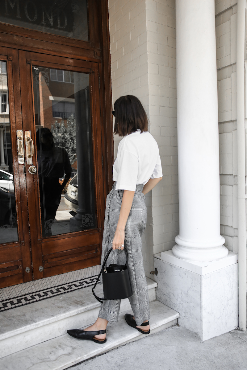 balenciaga logo tee t shirt street style fashion blogger minimal Ellery Kool Aid check pants staud bucket bag pointed flats Instagram (5 of 6)