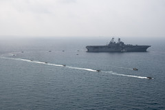 GULF OF THAILAND (Feb. 17, 2018) Amphibious assault vehicles, assigned to the 3d Marine Division, transport Marines from the amphibious assault ship USS Bonhomme Richard (LHD 6) to shore as part of Exercise Cobra Gold 2018. Bonhomme Richard is participating in CG18 alongside Royal Thai Navy ships and personnel, conducting a range of amphibious operations that will enhance the tactical expertise of participants and rehearse combined capabilities to respond to contingencies. Cobra Gold is an annual exercise conducted in the Kingdom of Thailand held this year from Feb. 13-23 with seven full participating nations. (U.S. Navy photo by Mass Communication Specialist 2nd Class William Sykes/Released)