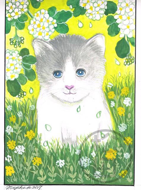 Cute kitten and spirea