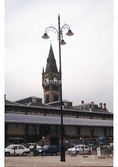 Covered market, clock and teardrop lamp in Market Place