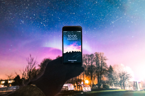 astronomy atmosphere blue cellphone clouds dark device electronics evening hand holding illuminated iphone iphone6 landscape lights longexposure mobile phone night sky outdoors road screen silhouettes smartphone space starrynight stars takingphoto technology timelapse trees