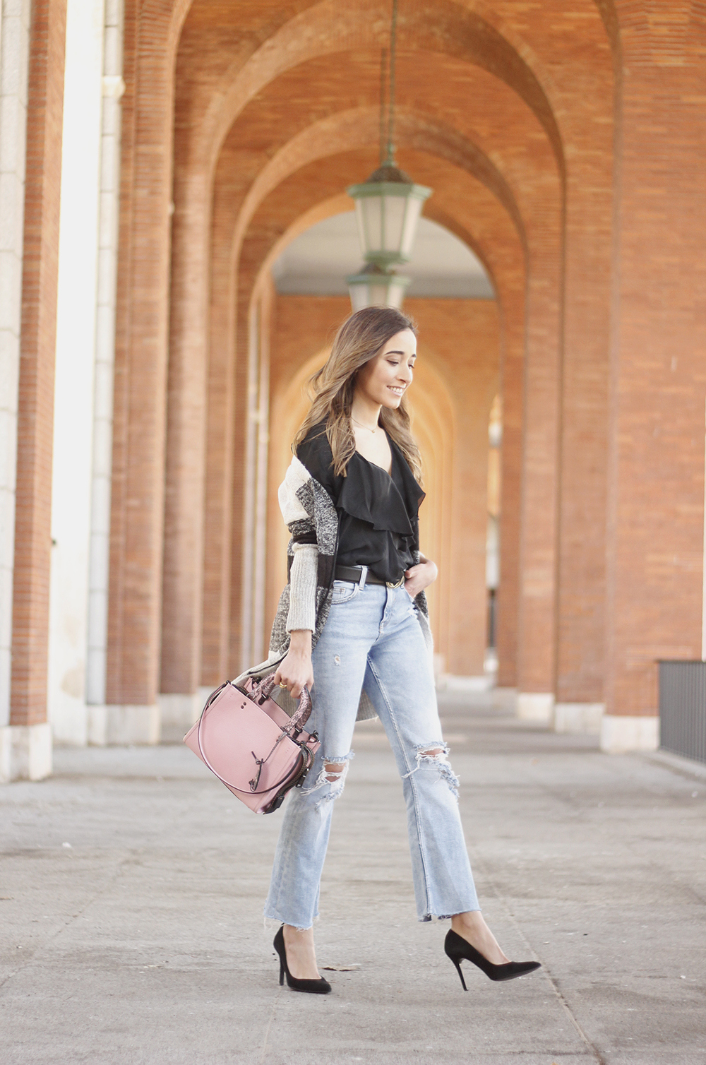 pink coach bag black heels ripped jeans inside cardigan casual winter outfit01