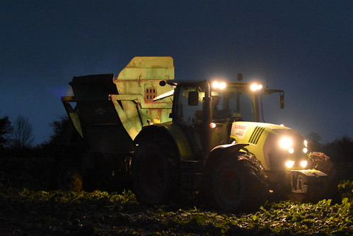 Claas Arion 640 Tractor with an Armer Salmon Beever Twin Row Beet Harvester