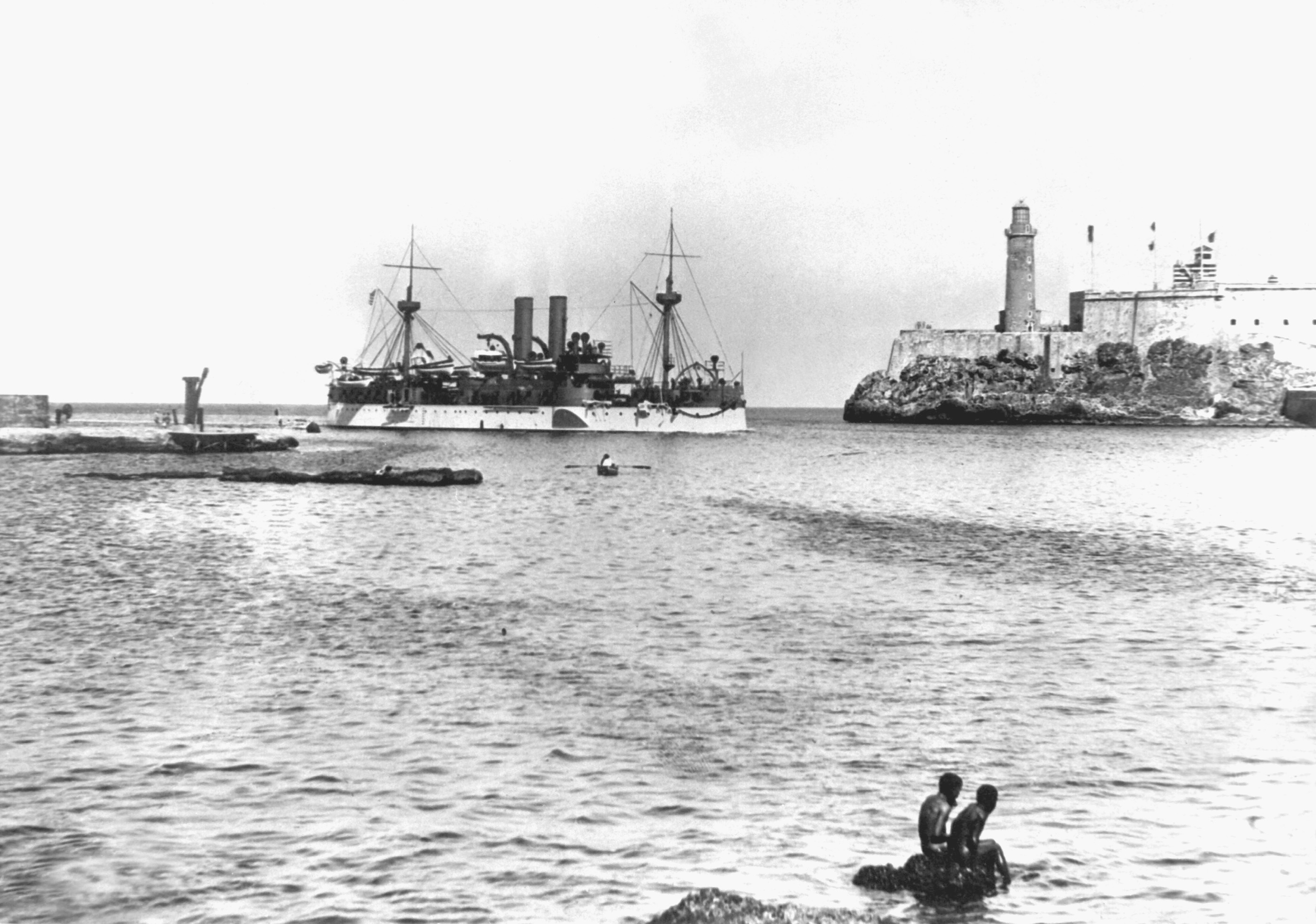 USS Maine entering Havana Harbor on 25 January 1898, where the ship would explode three weeks later. On the right is the old Morro Castle fortress.