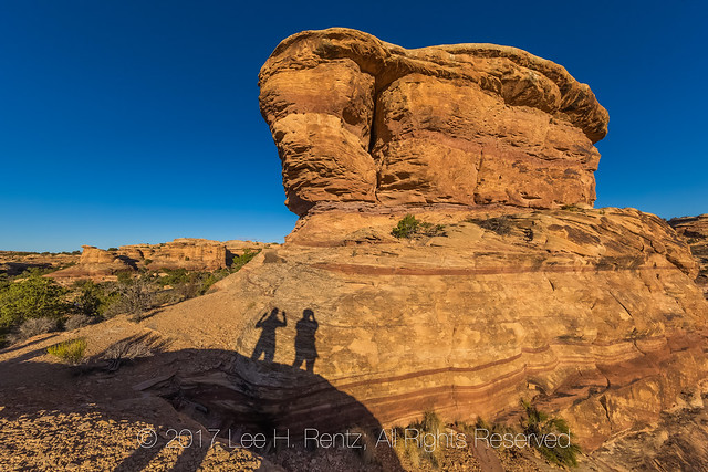 Hikers Casting Shadows at Day's End in Canyonlands National Park