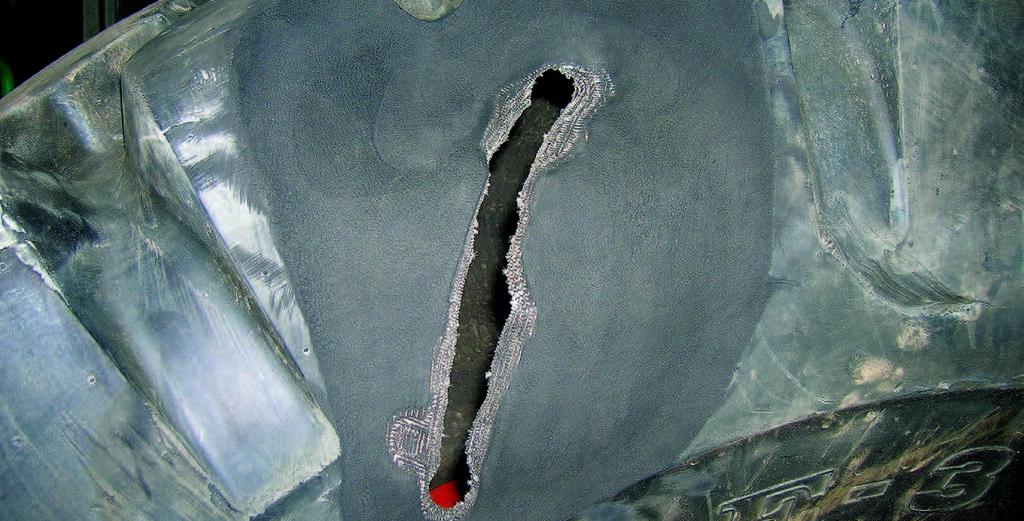 Поврежденная крупногабаритная шина (КГШ)
