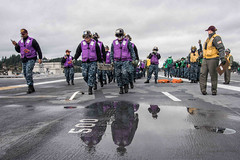 In this file photo, Sailors assigned to USS John C. Stennis (CVN 74) participate in a fire fighting and mass casualty drill on the ship's flight deck Jan. 23. (U.S. Navy/ MC3 William Ford)