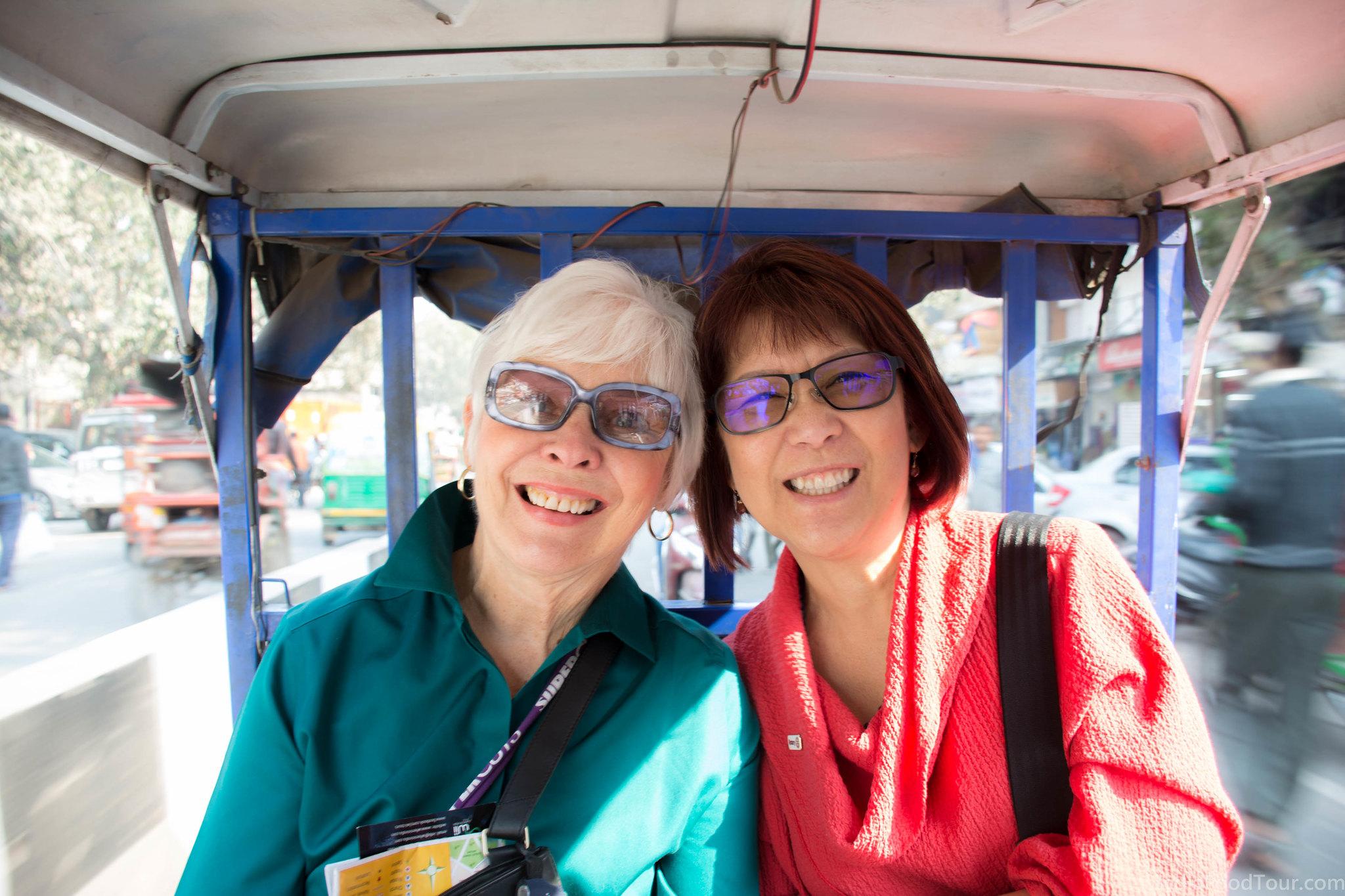Enjoying a rickshaw ride in Chandni Chowk