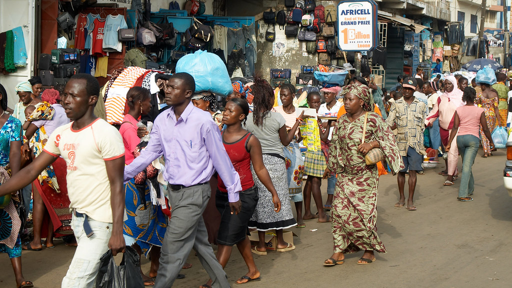 People moving on one of the busiest streets of the capital Freetown - The Abacha Road.