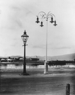 View of an old gas light alongside an electric street light in Townsville, June, 1922