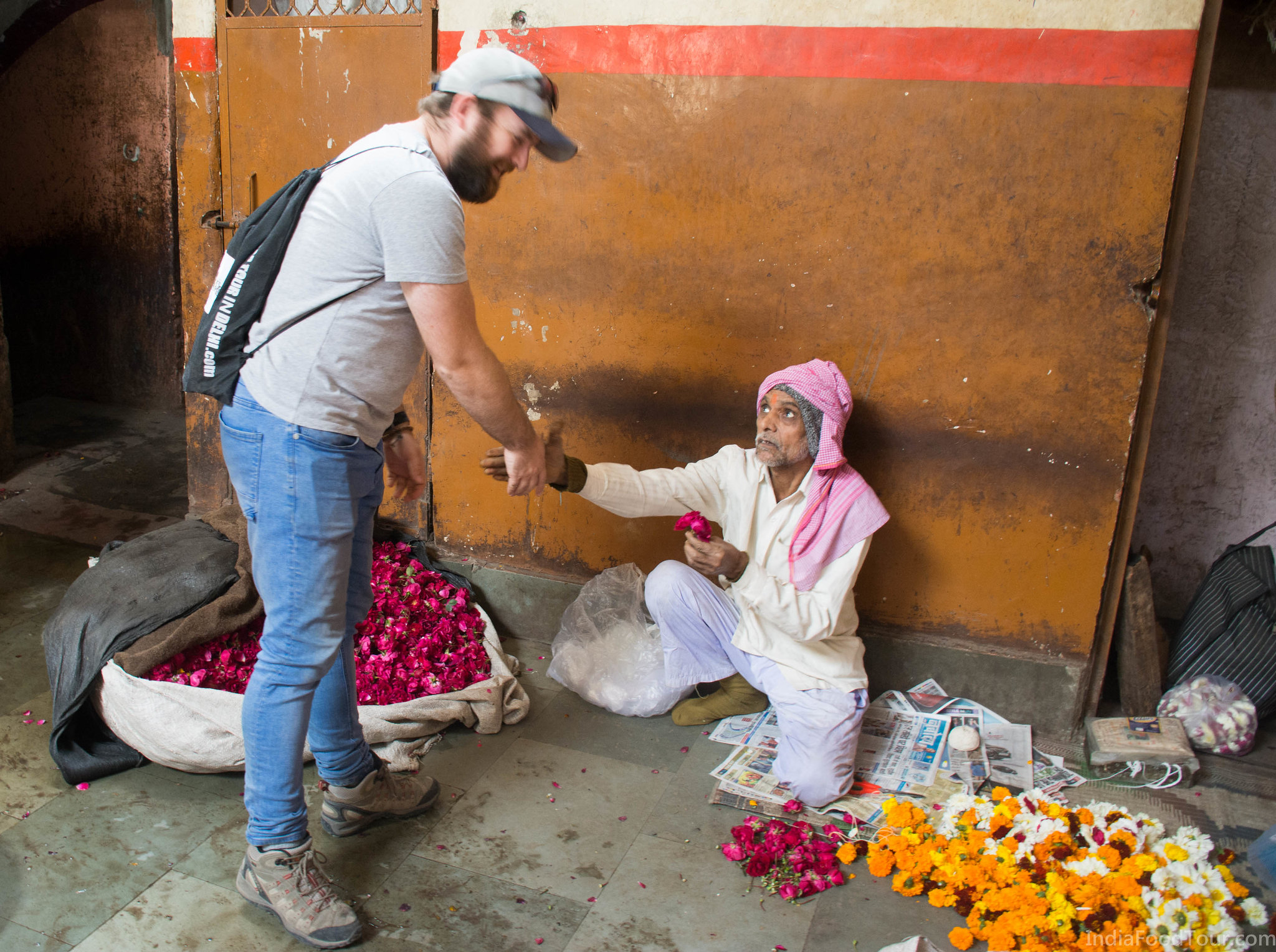 A flower vendor gifting a rose to one of our guests