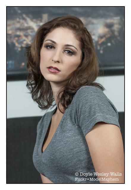 Portrait of Carlotta in a Simple Gray Shirt