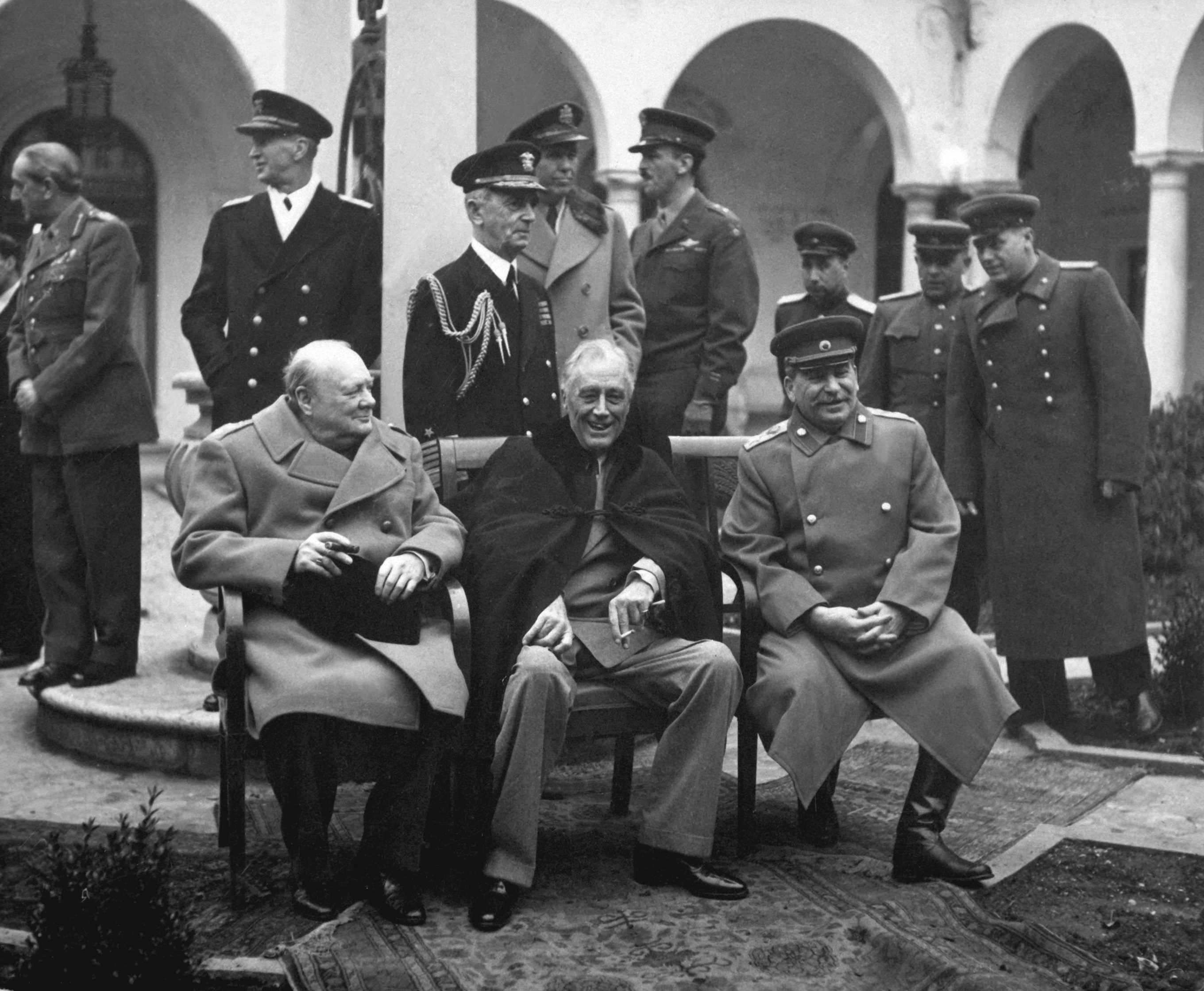 British Prime Minister Winston Churchill, U.S. President Franklin Roosevelt, and Soviet leader Joseph Stalin met at Yalta in February 1945 to discuss their joint occupation of Germany and plans for postwar Europe. Behind them stand, from the left, Field Marshal Sir Alan Brooke, Fleet Admiral Ernest King, Fleet Admiral William D. Leahy, General of the Army George Marshall, Major General Laurence S. Kuter, General Aleksei Antonov, Vice Admiral Stepan Kucherov, and Admiral of the Fleet Nikolay Kuznetsov. February 1945. (Army) Exact Date Shot Unknown NARA FILE #: 111-SC-260486 WAR & CONFLICT BOOK #: 750