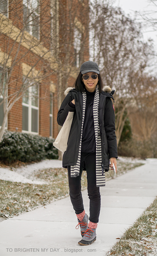 gray baseball cap, black parka, striped scarf, canvas tote, red camp socks, snow boots