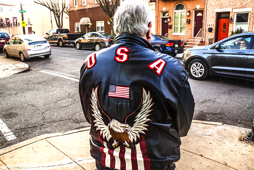 Man with USA jacket outside O'Jung--Pennsport