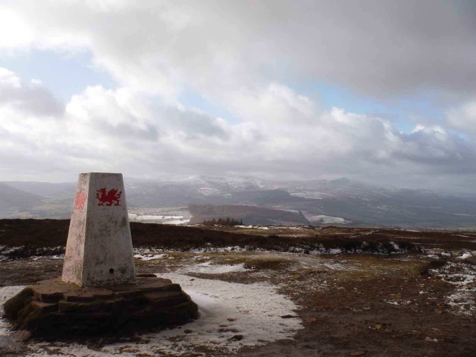 Trig Point on Mynydd Llangorse, with Central Beacons in distance SWC Walk 308 - Bwlch Circular (via Mynydd Troed and Llangorse Lake)