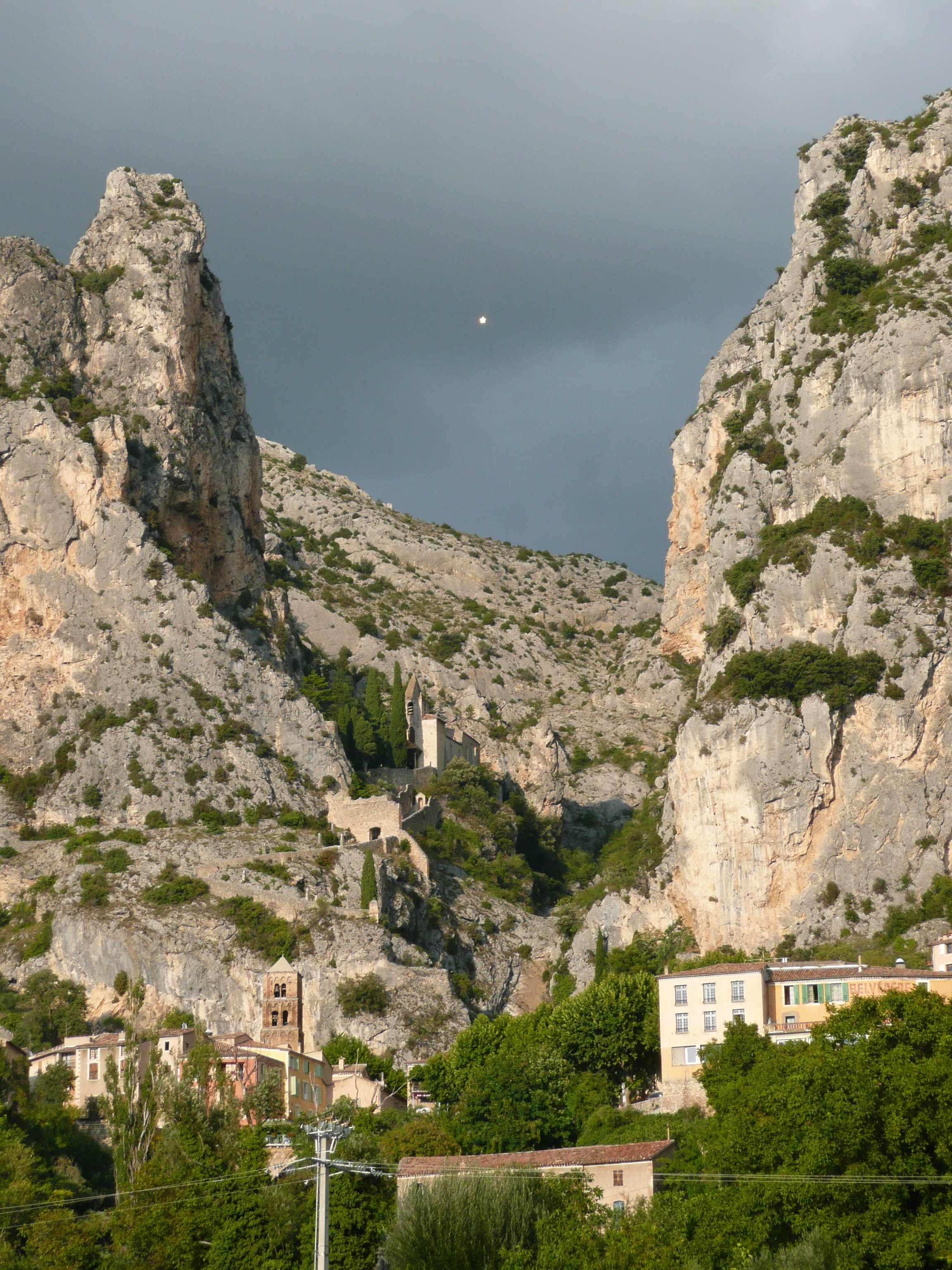 The peaks above the village of Moustiers-Sainte-Marie, with the famous star suspended between. Photo taken on September 20, 2008.