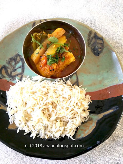 Tilapia fish curry with spring onions and potaotes
