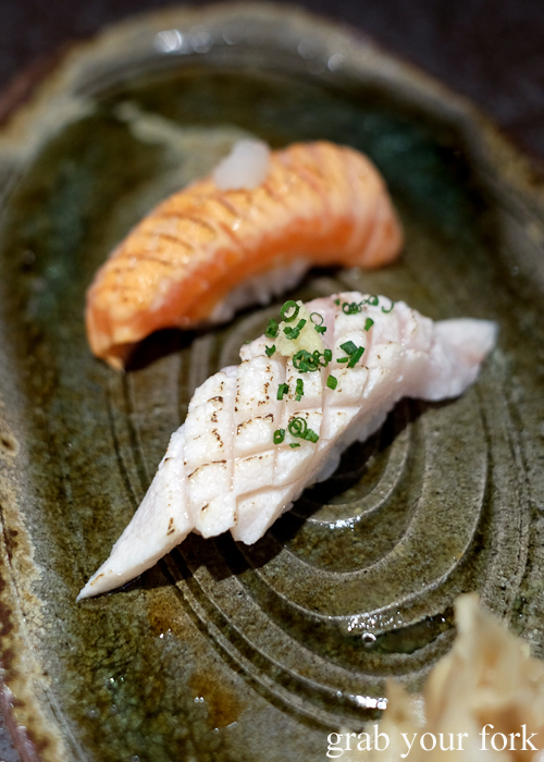 Aburi Tasmanian swordfish belly nigiri sushi and aburi ocean trout nigiri sushi, part of our omakase by Chef Ryuichi Yoshii at Fujisaki by Lotus at Barangaroo in Sydney