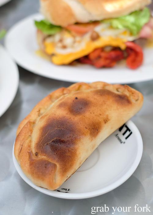 Uruguayan empanada at Uruguayan bakery cafe Confiteria Lion D'Or in Carramar