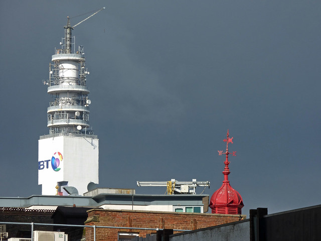 BT Tower and the red weather vane of the former Skin Hospital