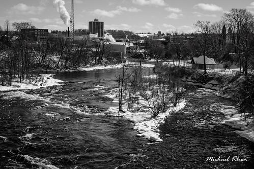 blackriver watertown newyork jeffersoncounty winter snow water river rapids blackandwhite industry