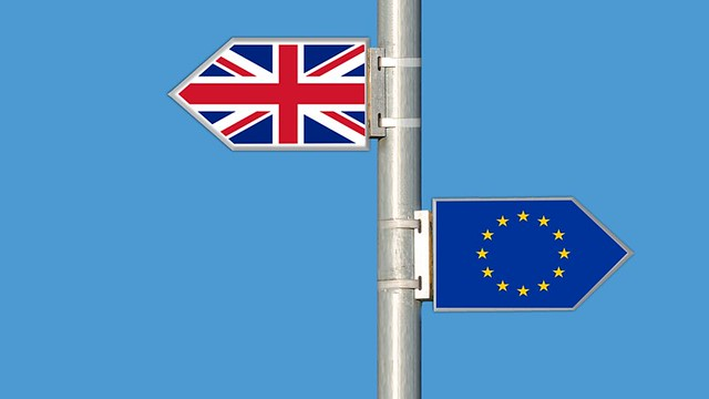 A UK flag and an EU flag on the same pole but pointing in the opposite direction.