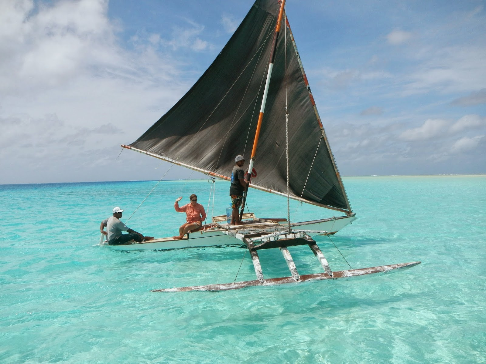 A small outrigger sailing canoe, seen in the waters off Fiji.