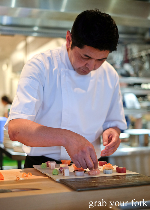 Chef Ryuichi Yoshii plating his sashimi platter at Fujisaki by Lotus at Barangaroo in Sydney