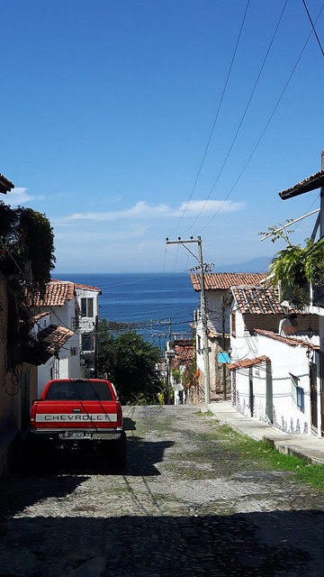 Cobblestone streets of Puerto Vallarta overlooking the ocean.