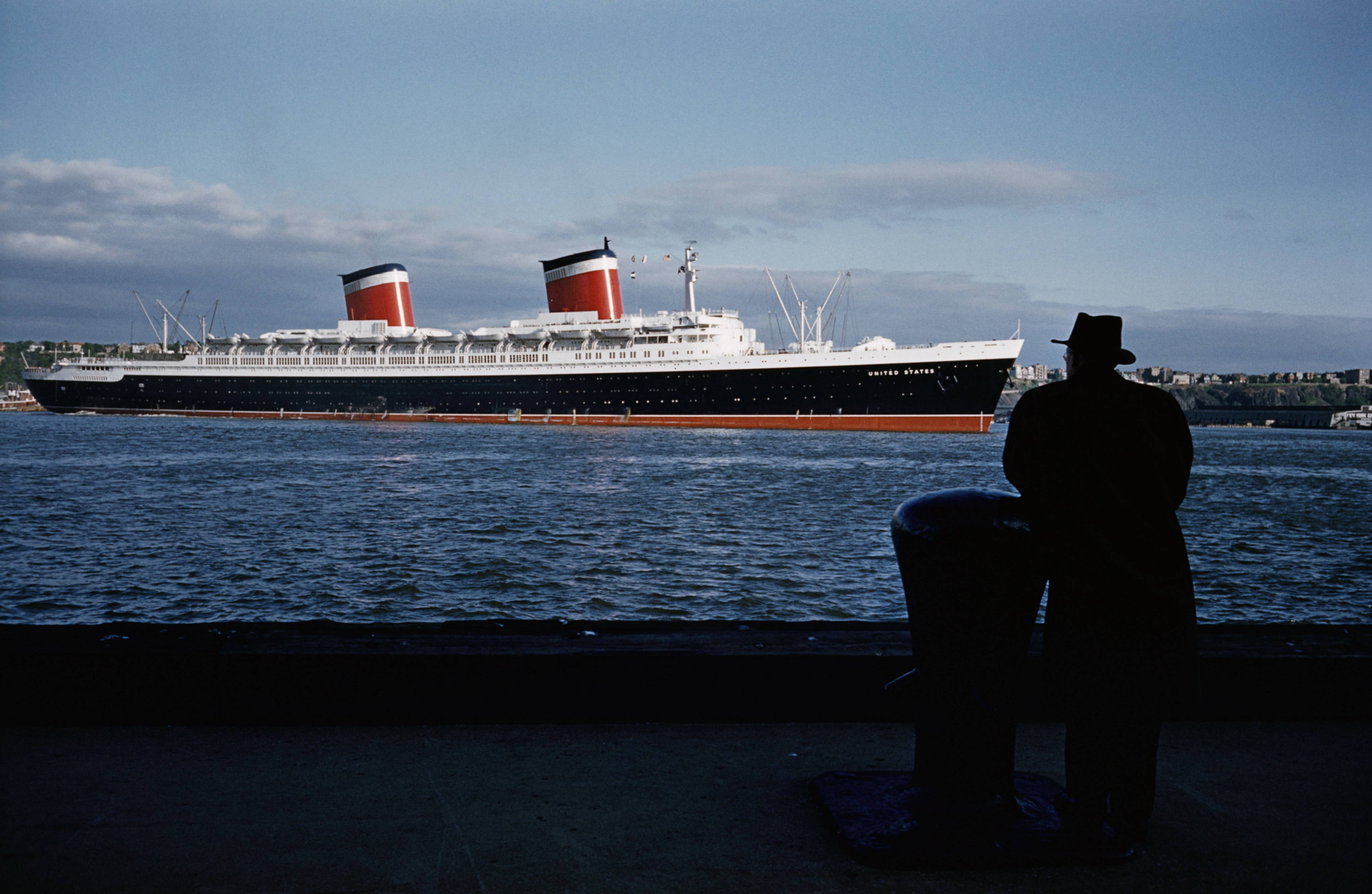 Naval architect William Francis Gibbs observing his creation the SS United States upon arrival at New York harbor.
