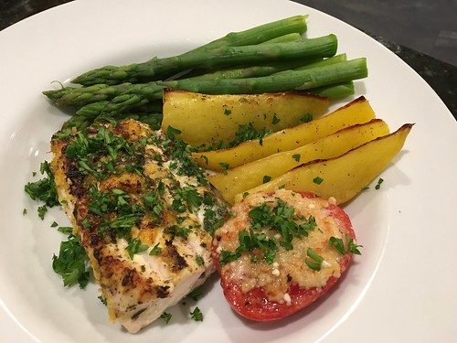 Broiled halibut, roasted yukon golds, poached asparagus and broiled garlic and parmesan roma tomato