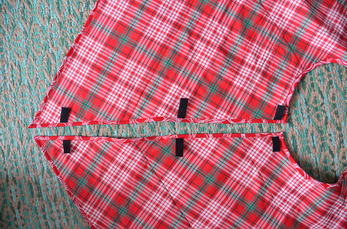 Sew binding to backside of the quilt. As you attach binding to back side of quilt, ensure you're sewing to the left of the seam attaching binding to right side of the quilt. This will produce a seam line on the front of the quilt.