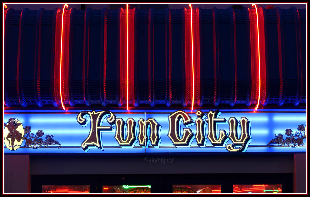 "Fun Fun City  We saw this on the way back from the pub in Whitby after we had watched Manchester City win (again). It certainly is fun watching them these days. I had a season ticket at Maine Road back in the day - during the Bell, Summerbee, Lee, Marsh, Tueart days and went to the League Cup Final at Wembley in the 70s. We get to go to The Etihad now and again these days.  I also like the light blue on the background of this fine neon sign which is like City's home strip.  This photo fits into quite a lot of my Flickr Albums:-  Blue <a href=""https://www.flickr.com/photos/dave_kepcove/albums/72157623445650527"">www.flickr.com/photos/dave_kepcove/albums/72157623445650527</a>  Red <a href=""https://www.flickr.com/photos/dave_kepcove/albums/72157640713565915"">www.flickr.com/photos/dave_kepcove/albums/72157640713565915</a>  Signs That I Like <a href=""https://www.flickr.com/photos/dave_kepcove/albums/72157625418585257"">www.flickr.com/photos/dave_kepcove/albums/72157625418585257</a>  Northern England <a href=""https://www.flickr.com/photos/dave_kepcove/albums/72157606891221138"">www.flickr.com/photos/dave_kepcove/albums/72157606891221138</a>  Buildings, Bridges and Mosaics <a href=""https://www.flickr.com/photos/dave_kepcove/albums/72157606788081518"">www.flickr.com/photos/dave_kepcove/albums/72157606788081518</a>  Lettering Of Some Kind <a href=""https://www.flickr.com/photos/dave_kepcove/albums/72157625538532139"">www.flickr.com/photos/dave_kepcove/albums/72157625538532139</a>  My Yorkshire Pics <a href=""https://www.flickr.com/photos/dave_kepcove/albums/72157623898903610"">www.flickr.com/photos/dave_kepcove/albums/72157623898903610</a>  and  Goths/Whitby/Goth Weekend.   <a href=""https://www.flickr.com/photos/dave_kepcove/albums/72157652260115112"">www.flickr.com/photos/dave_kepcove/albums/72157652260115112</a>"