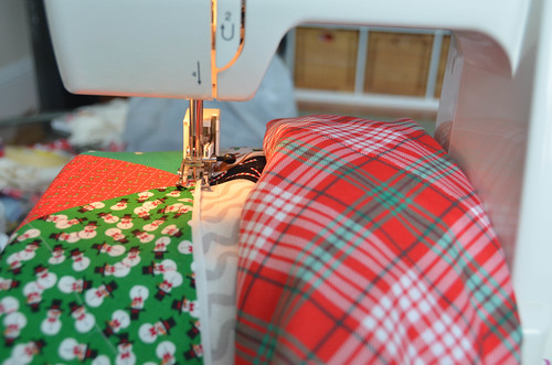 Quilting - Use walking foot on sewing machine to quilt chosen pattern. Try to start sewing outside of the quilt, so that you don't have to worry about thread ends getting in the way, nor about using tiny stitches to secure the beginning of the thread.