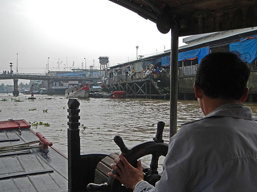 On a boat going down the industrial portion of the Mekong River in Vietnam