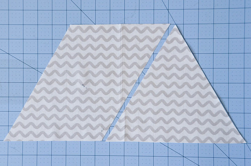 Unfold fabric and cut one last triangle from it.