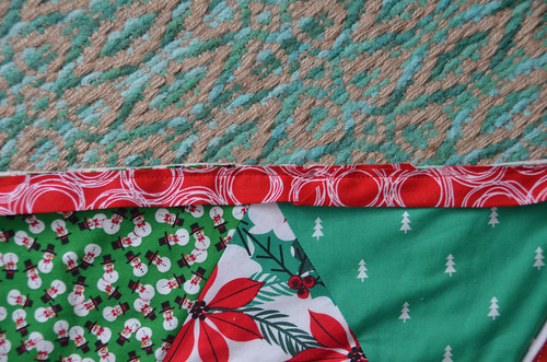 "Sew binding to front of quilt with 1/4"" inseam (align raw edges and sew, fold of binding should be on interior)."