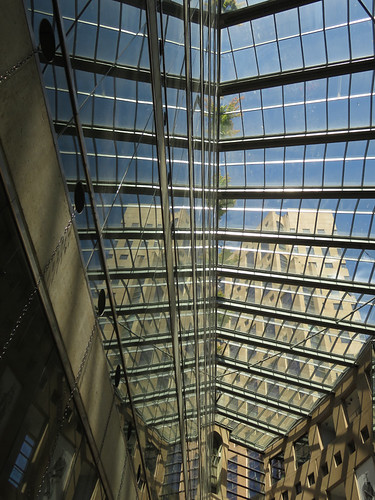 Mirrored images of the outside buildings as seen through the glass roof of the Vancouver Public Library, Canada