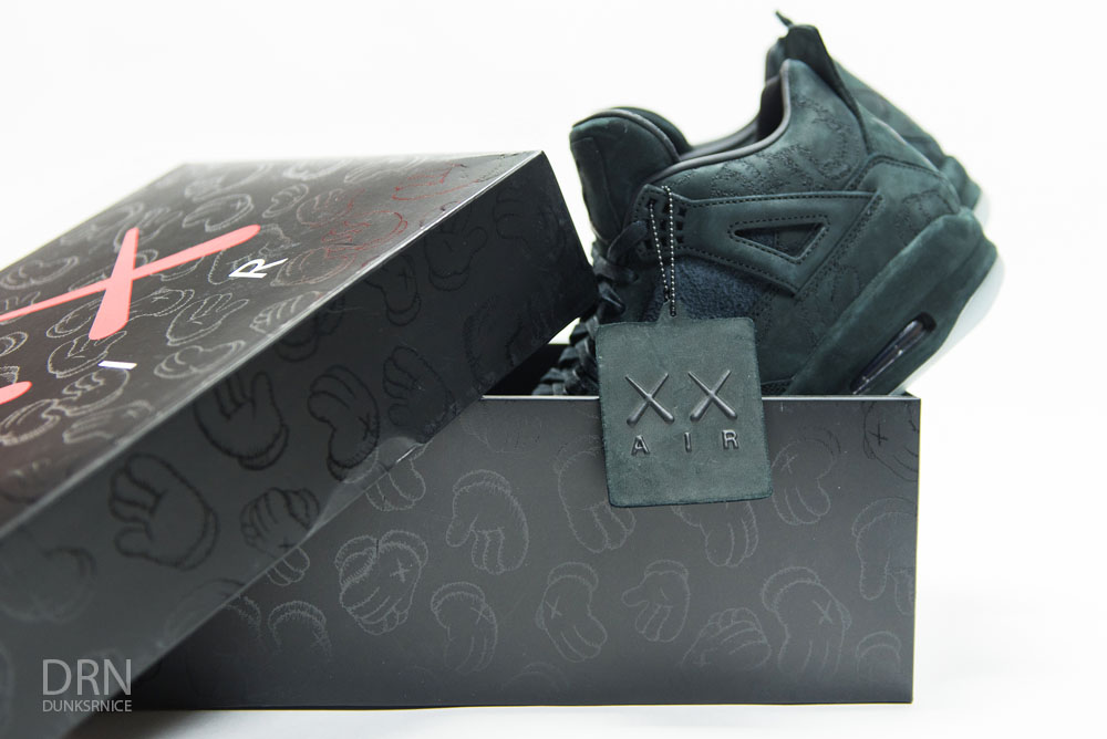 Jordan 4 KAWS Black.