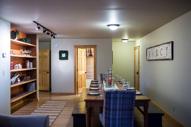 Dining area with built in shelving and 1/2 bath;